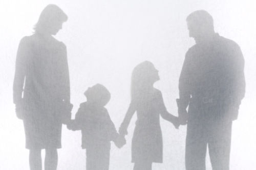 Silhouette of kids and parents with joint custody