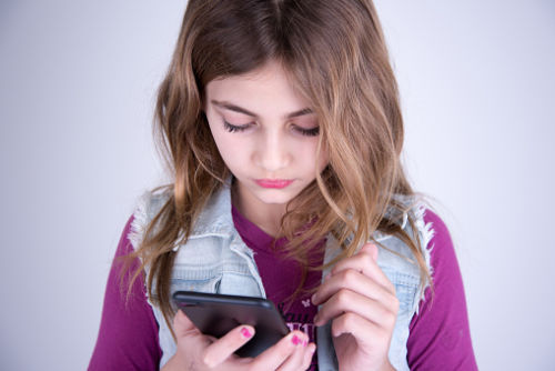 Girl with smartphone - Technology to Connect with Your Kids