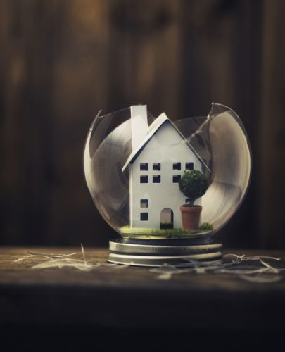 Model of Home in Broken Glass Globe - Law Office of Shelly Ingram