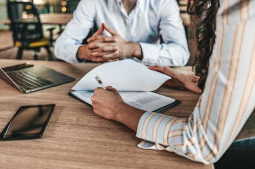 People negotiating a divorce agreement
